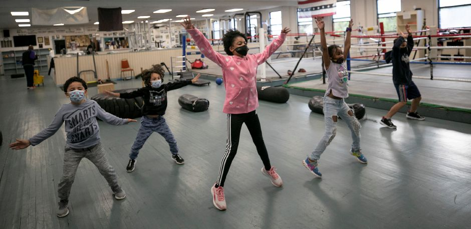 Children start their exercise program with repetitions of jumping jacks at Beat the Street Community Center in Meriden, Wed., Oct. 7, 2020. Dave Zajac, Record-Journal