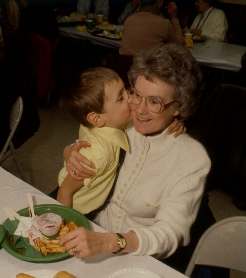 RJ file photo - Shirley Bastura gets a kiss from grandson Joseph, 5, at a luncheon for grandparents at Mt. Carmel School in Meriden, Jan. 1990.