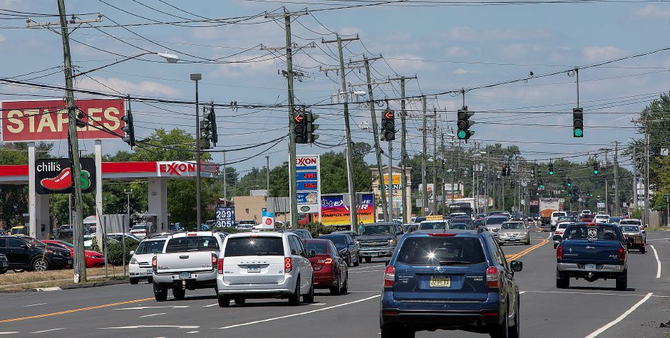 Motorists travel on Queen Street in Southington, July 20, 2018. Dave Zajac, Record-Journal