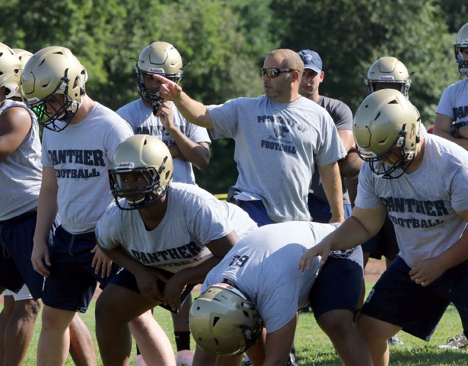 Platt head football coach Jason Bruenn works with his players Tuesday during the first week of practice. Photos by Aaron Flaum, Record-Journal