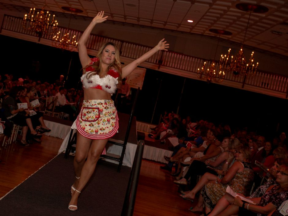 "Carolina Villamizar works the runway wearing ""Sweet Life"" during the Art Bra 2018 Runway Show and Auction Aug. 9, 2018 at the Aqua Turf in Southington. 