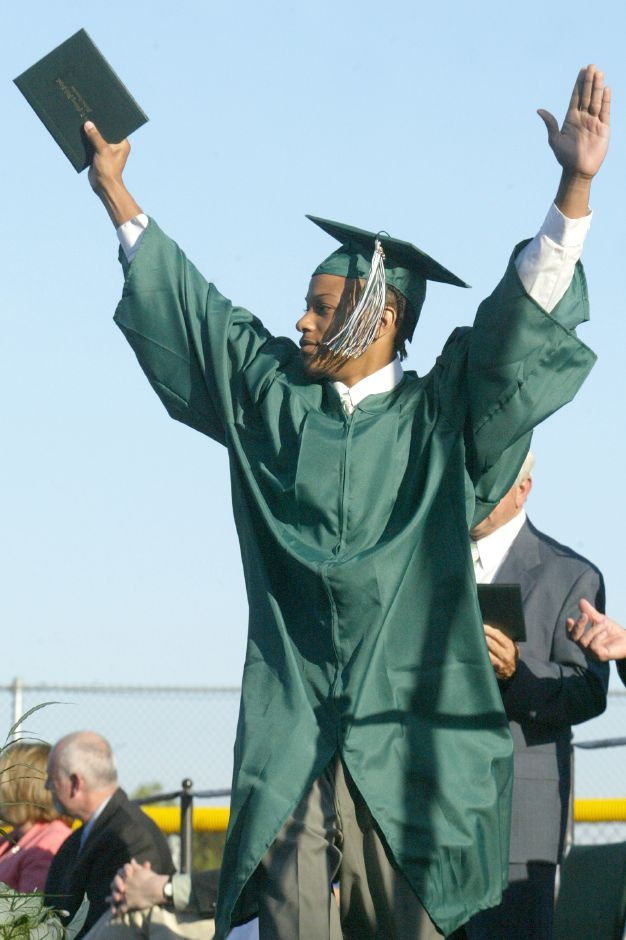 Record Journal Photo/ Johnathon Henninger 6.18.07 Dante Bacote raises his arms to the crowd after recieving his diploma at the Maloney High School Graduation in Meriden Monday afternoon.