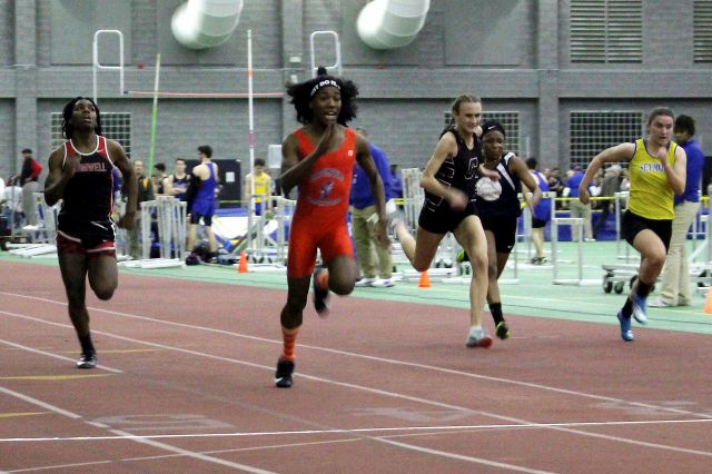 FILE - In this Feb. 7, 2019 file photo, Bloomfield High School transgender athlete Terry Miller, second from left, wins the final of the 55-meter dash over transgender athlete Andraya Yearwood, far left, and other runners in the Connecticut girls Class S indoor track meet at Hillhouse High School in New Haven, Conn. The U.S. Education Department