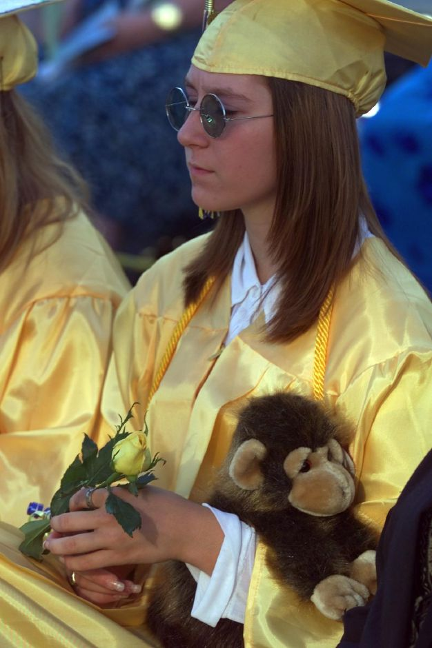 Melissa Bolduc, of the Wilcox Healty Technology class, clutches a stuffed monkey during graduation Fri., June 18, 1999.