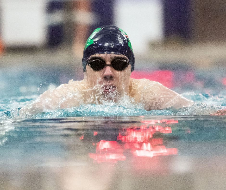 Sam Hurlburt won the 500 freestyle and 100 breaststroke and anchored the first-place 200 freestyle relay to lead the Meriden Co-op boys swim team to a 93-83 CCC crossover victory in Manchester on Tuesday. | Aaron Flaum, Record-Journal