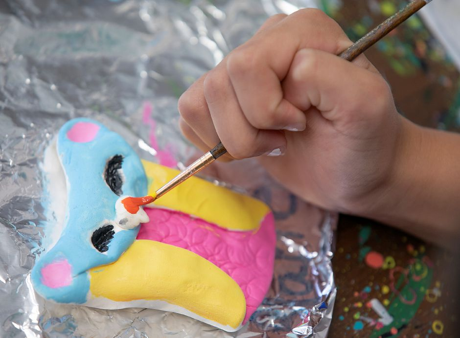 Blake Parsons, 9, of Wallingford, gives her owl an orange nose during an art camp at Catalyst Art Studio.
