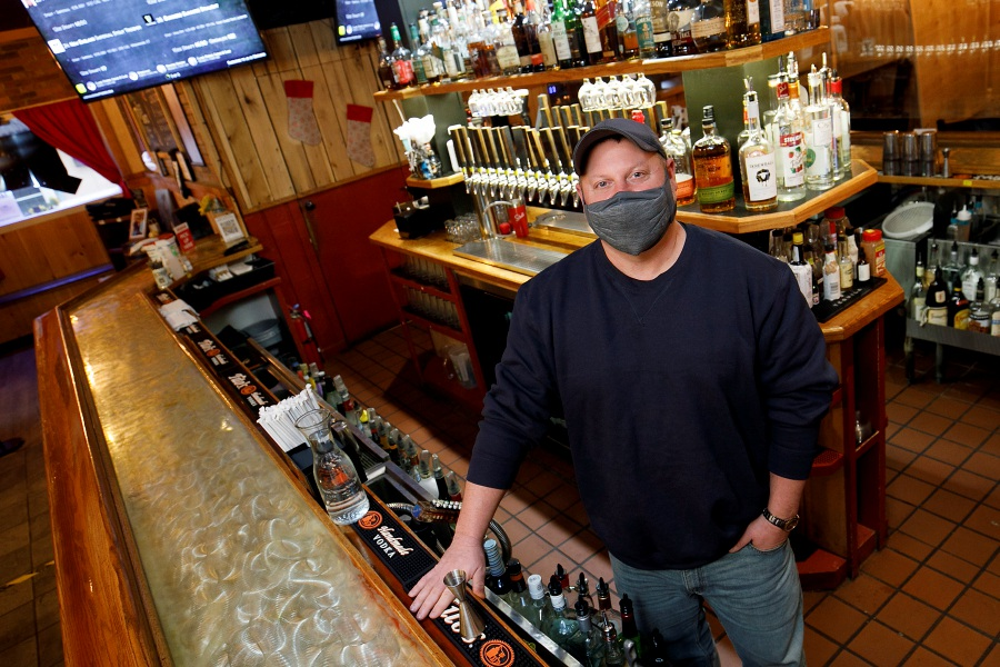 Michael Miller, owner of Hop Haus, stands behind the bar of the business in Plantsville. Hop Haus is planning to open a second location, in Plainville.Dave Zajac, Record-Journal