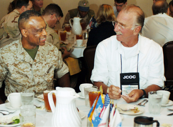 Ed Shanahan, right, president of Choate Rosemary Hall in Wallingford, Conn., speaks with U.S. Marine Corps Brig. Gen. Anthony Jackson, deputy commander of U.S. Marine Forces Central Command, during a luncheon at that United States Central Command headquarters on MacDill Air Force Base in Tampa, Fla., April 24, 2006. The JCOC is a weeklong, multi-service orientation for civilian public opinion leaders during which participants attend high-level briefings at the United States Central Command (CENTCOM) headquarters, observe exercises, fire weapons, and participate in training at various locations in the CENTCOM area of responsibility. DoD photo by Public Affairs Specialist 2nd Class Larry Chambers, U.S. Coast Guard. (Released)