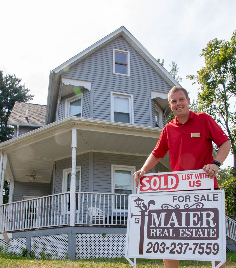 John Maier stands in front of a Meriden home that recently sold. Aaron Flaum, Record-Journal