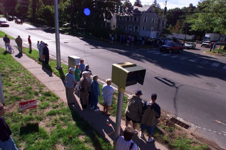 Tree preservationists and others gather on the corner of East Main St. and Parker Avenue during Sunday morning