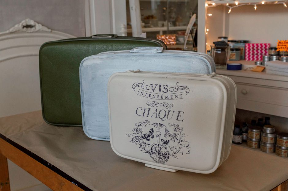 The suitcase on the far right once had the same outdated green color as the one on the far left. After just two coats of paint and a trensferred design, it is ready to hold cards at a wedding. - at 2 Sister