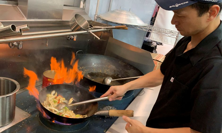 Co-owner Eric Huang cooks a chicken teriyaki dish at his new restaurant, Hot Pot, in Wallingford, on Wednesday.