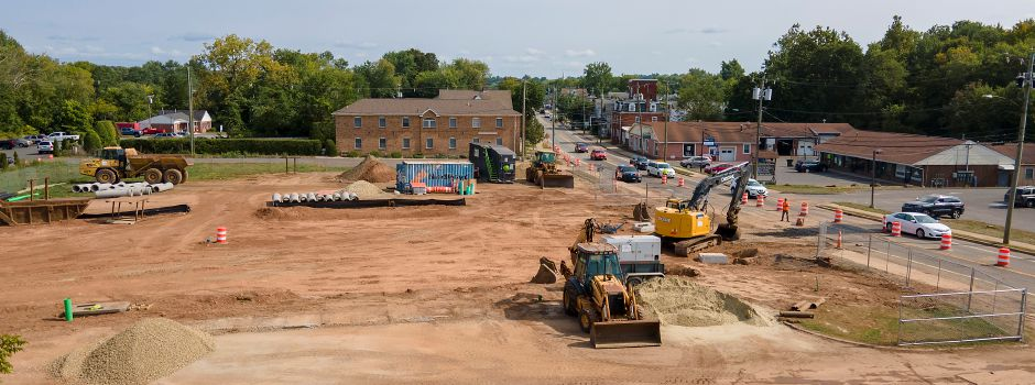 Construction continues on the Boulevard to Berlin Train Station and Steele Center developments on Farmington Avenue in Berlin, Friday. Traffic navigates alongside the construction zone on Farmington Avenue, right. Dave Zajac, Record-Journal
