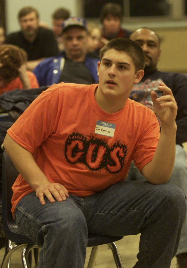Tom Patierno, a student at Platt High School in Meriden, asks a question about the rules of an upcoming robitics competition during a team meeting at Platt High School Jan. 6, 2001.