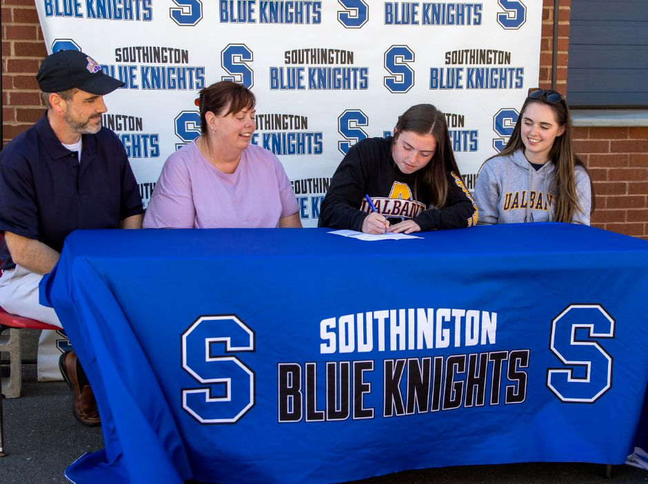 Flanked by her parents Scott and Mary Ellen on her right and sister Johannah on her left, Southington soccer player Shannon Litchfield signed a National Letter of Intent with Division I University of Albany on Dom's Way outside of Southington High School on Thursday. Aaron Flaum, Record-Journal
