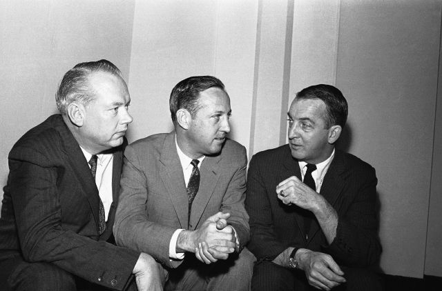 FILE - In this Feb. 14, 1966, file photo, NFL football commissioner Pete Rozelle, center, discusses a new Television contract for championship games with Bill MacPhail, left, Vice President CBS TV and John Reynolds President CBS TV network, in Palm Beach, Fla. Television fueled the success of the NFL and AFL in the decade before their 1970 merger, and expansion that pushed pro football into the deep South grew out of assurances from then-Commissioner Pete Rozelle that AFL franchises...