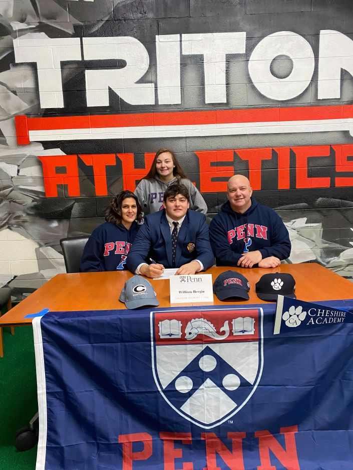 During a Dec. 16 ceremony at Triton Athletics in Wallingford, Cheshire's Will Bergin was recognized for commiting to study and play football at the University of Pennsylvania. Bergin is seated between his mother Krista and father Steve. Bergin