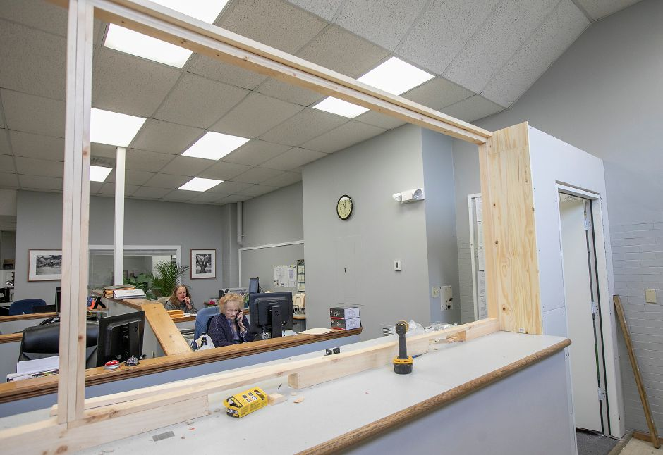 Kim Touchette, secretary, front, and Karen Wasilewski, senior clerk, answer phones in the Building Department at Wallingford Town Hall, Wed., Mar. 25, 2020. Town crews are installing new counter windows in several offices. Dave Zajac, Record-Journal