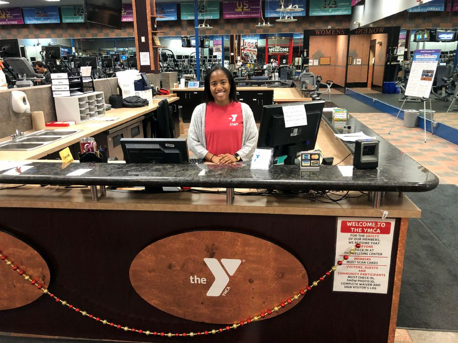 Wilson sits at the front desk where she greets members as they come in. | Kristen Dearborn, special to the Record-Journal