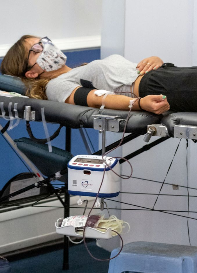 Miranda Cuddy of Cheshire, lays on a table as blood is collected during a blood drive at the Cheshire Masonic Temple Lodge in Cheshire on Friday, September 11, 2020. Aaron Flaum, Record-Journal