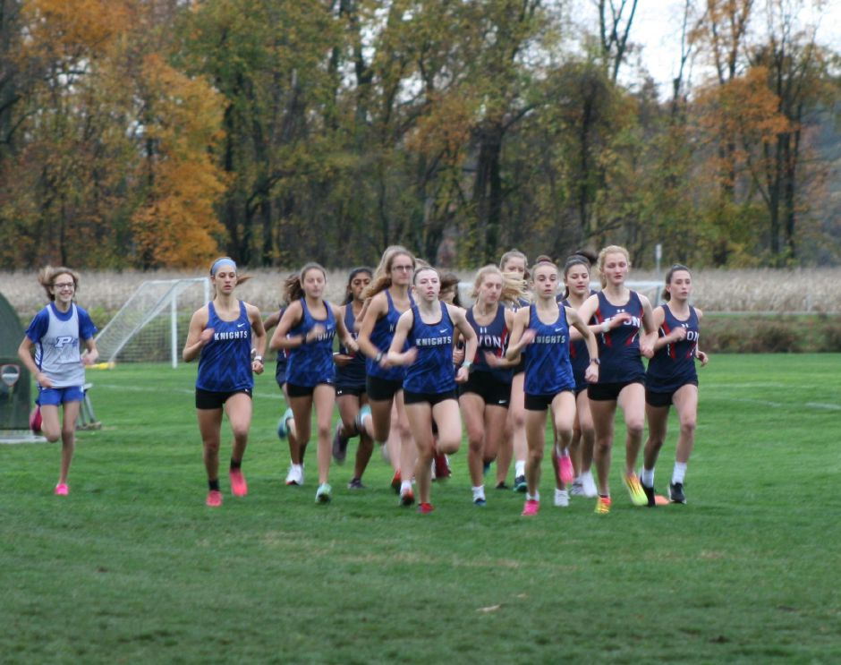 The Southington girls cross country team is off and running to its program-record cumulative time of 96:34 Wednesday at Fisher Meadows in Avon. Grace Michaud (foreground, right) set a Southington girls 5K record with an 18:38. Photo courtesy of Dan Dachelet