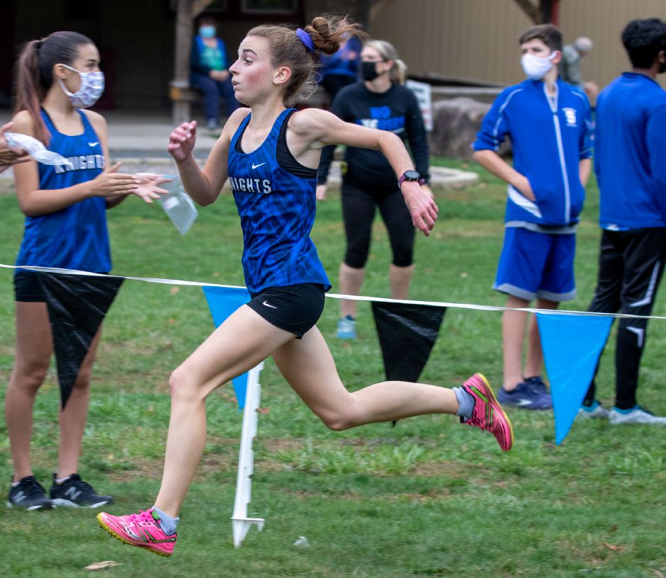 Southington senior Grace Michaud broke her own program record Tuesday in winning the CCC Region B cross country meet at New Britain's Stanley Quarter Park in a time of 18:35. Aaron Flaum, Record-Journal