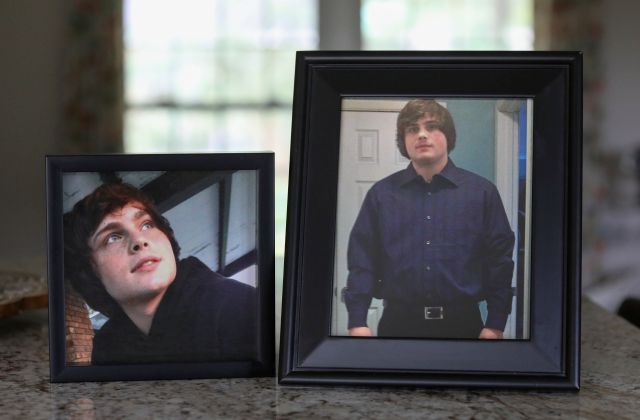 In this Friday, Sept. 13, 2019, photo, Denise Spence shows photos of her son Timothy at her home in Elk Grove Village, Ill. Spence said Timothy died of an opioid overdose. While the nation