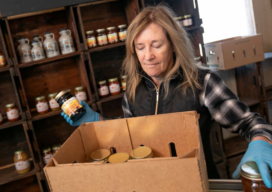 Linda DeFrancesco stocks shelves with her farm