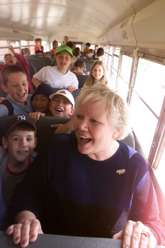 Karen Smith, principal of Derynoski Elementary School in Southington, mingles with students on the bus at the end of a school day. Smith, who won the statewide national distinguished principal award, in 2002, died last month at the age of 72. | File photo.