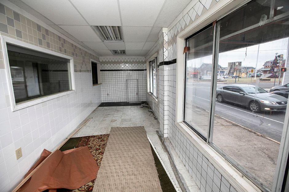 View from inside a building at 4 Center St. along North Colony Road, right, in Wallingford, Thurs., Dec. 26, 2019. The building was recently purchased by a Wallingford couple who plan to fix it up and rent it out, but there are no prospective tenants yet. The building was erected in 1900 and is zoned as mixed residential and commercial use. Dave Zajac, Record-Journal