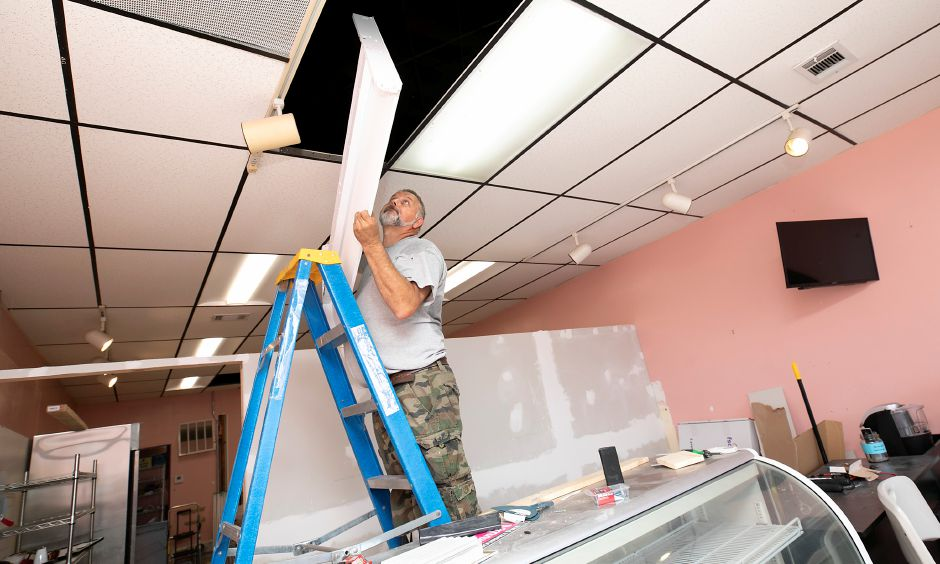 Alfonso Mascolo, owner of Kensington based Mascolo Electric, installs new LED lighting at Nonnie
