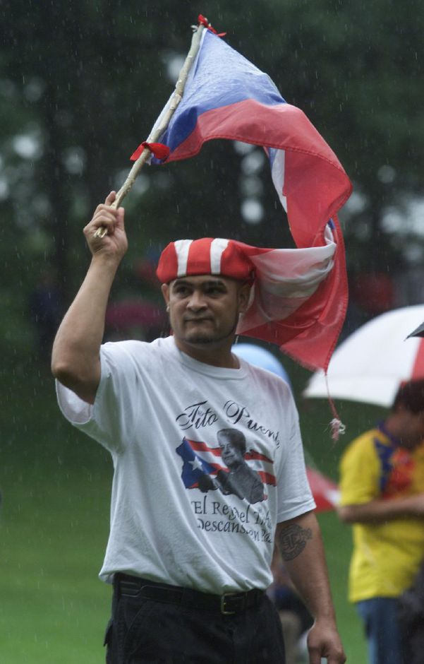 Jose Gonzalez of Meriden displays his Puerto Rican pride Sunday during the Puerto Rican festival at Hubbard Park Aug. 13, 2000.