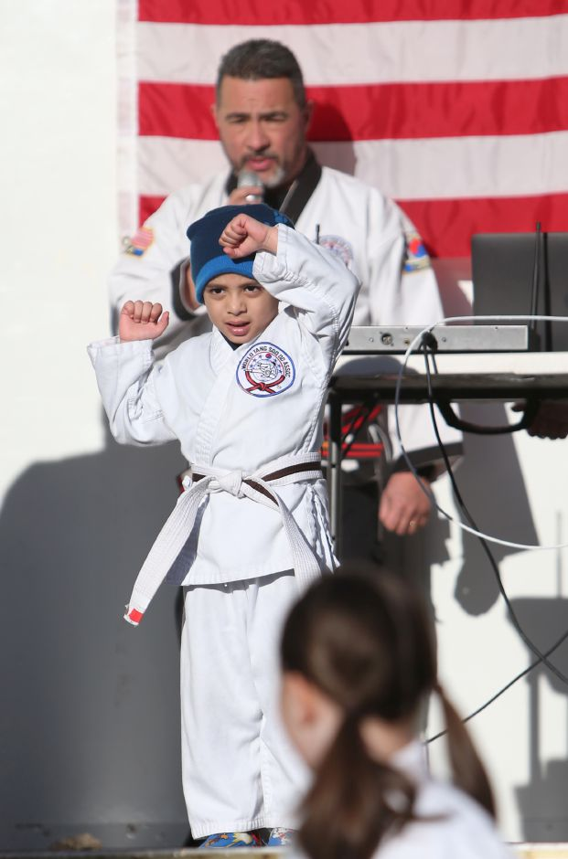 Ulises Berrios, 4, of Meriden, a student of the Valentin Karate school, demonstrates his skills at the annual Yulefest in Meriden on Saturday, Nov. 30, 2019. Emily J. Tilley, special to the Record-Journal.