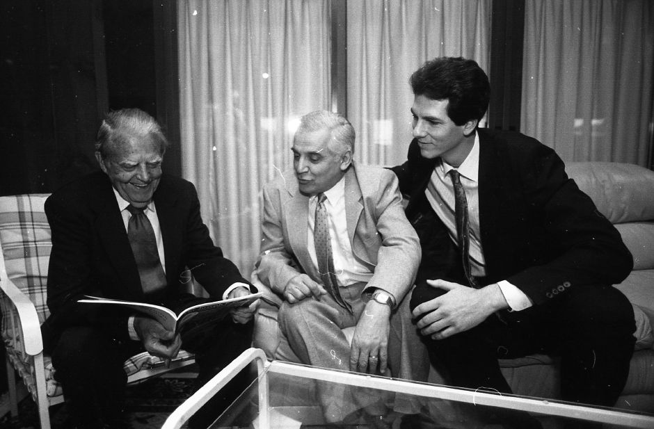 RJ file photo - Hall of Fame inductees Joe Coffey, Joe Schiopucie and Jay Murphy rekindle memories as they san the 100th anniversary booklet put out by the Boys Club, April 1989.