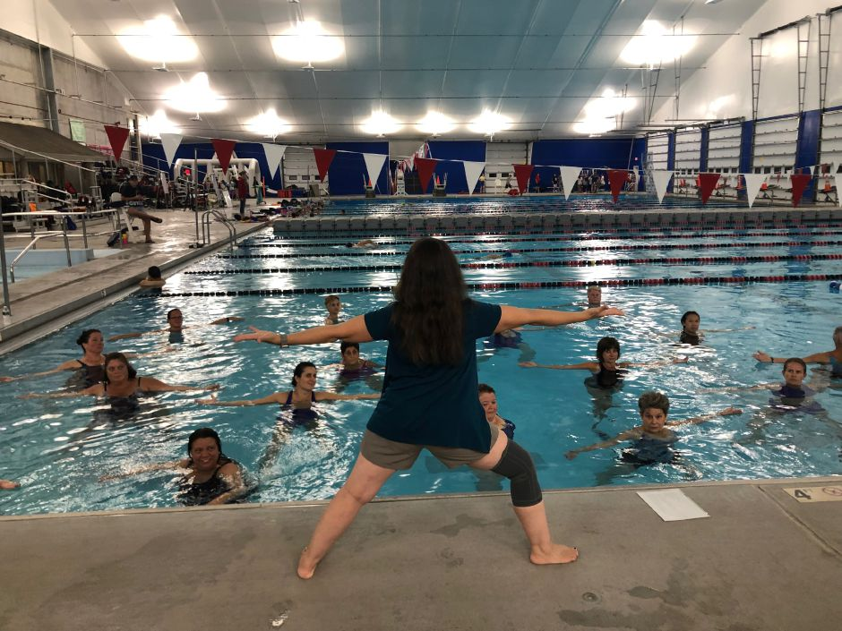 Cammuso demonstrates a yoga pose that requires balance at the Cheshire Community Pool. |Kristen Dearborn, Special to Record-Journal