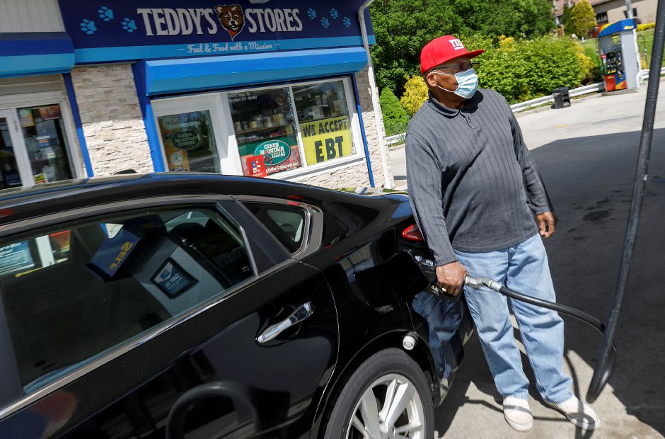 Kenneth Robinson, of Meriden, pumps gas into his vehicle at the Sunoco station at 1100 E. Main St., Meriden, on Tuesday. Dave Zajac, Record-Journal
