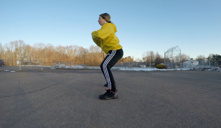 Kristen Dearborn demonstrates lateral walks as a part of a HIIT workout in winter weather. |Kristen Dearborn, Special to Record-Journal