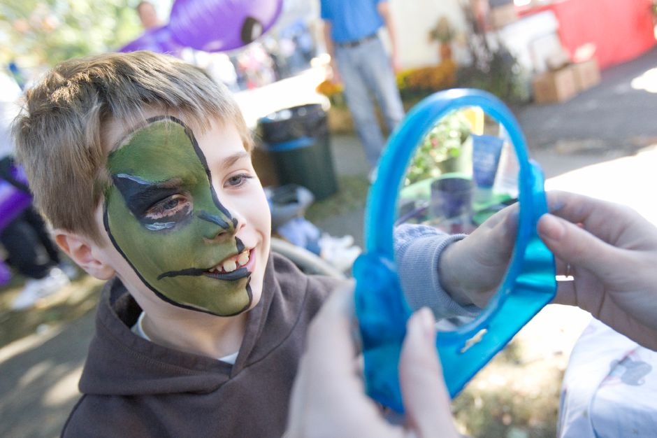 James Lukow, 7, of Hebron smiles reacting to his half-alien face painting by Jennifer Snow at the Apple Harvest Festival in Southington Saturday, October 9, 2010. (Johnathon Henninger/ Record-Journal)