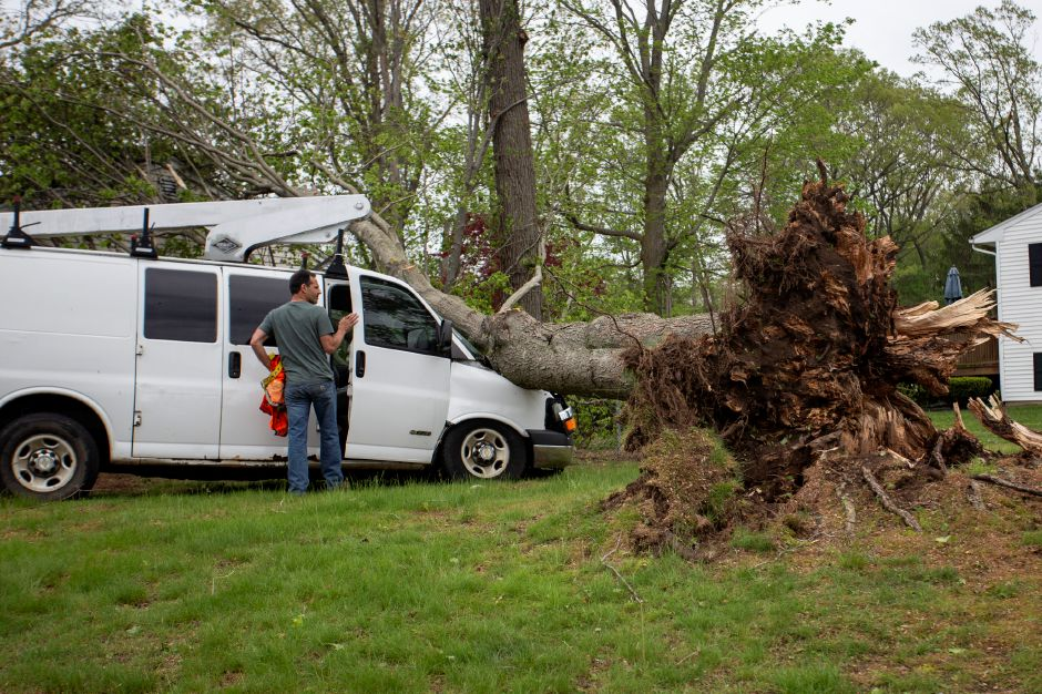 Dave Tolla looks at the damage while retrieving items from his truck on South Side Road in Wallingford May 16, 2018. Tolla, of DAT Contracting, left the truck at a customer
