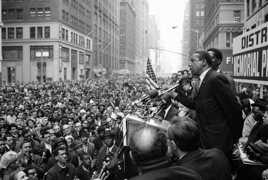 "Floyd McKissick, head of CORE, addresses a crowd of garment district workers who stopped work to attend a memorial meeting for Dr. Martin Luther King, Jr. at Seventh Ave. and 37th St. in New York, April 8, 1968. McKissick told the crowd: ""The reason you"