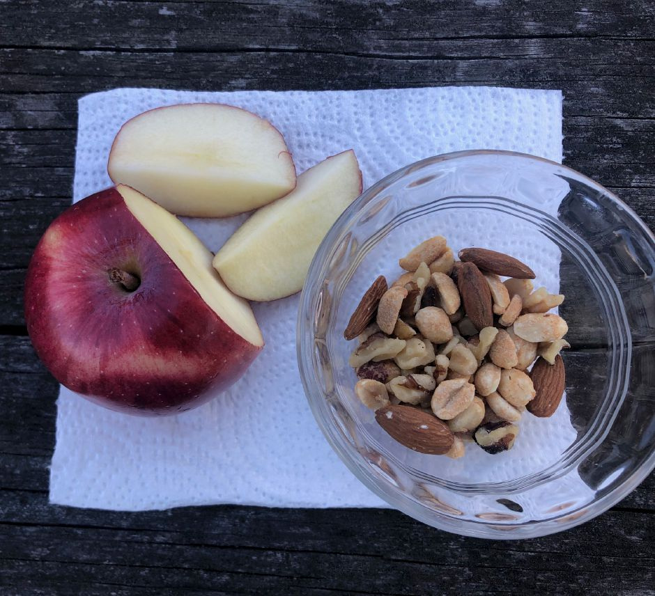 CT State-Certified Nutritionist Jennifer Thomas recommends nuts and a piece of fruit as a healthy snack during the holidays.
