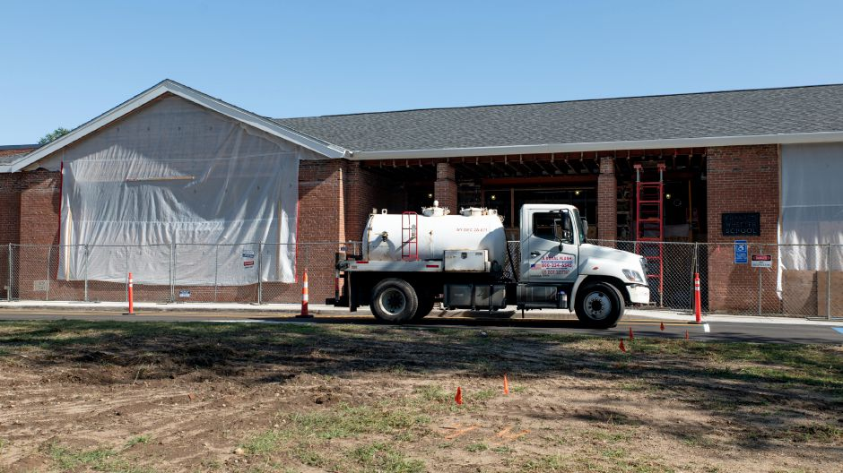The former main entrance to Wheeler Elementary School, in Plainville, remained under construction on the first day of school on Sept. 3, 2019. A new entrance was constructed with a security vestibule on the western side of the building, connecting to a new main office. | Devin Leith-Yessian/Plainville Citizen