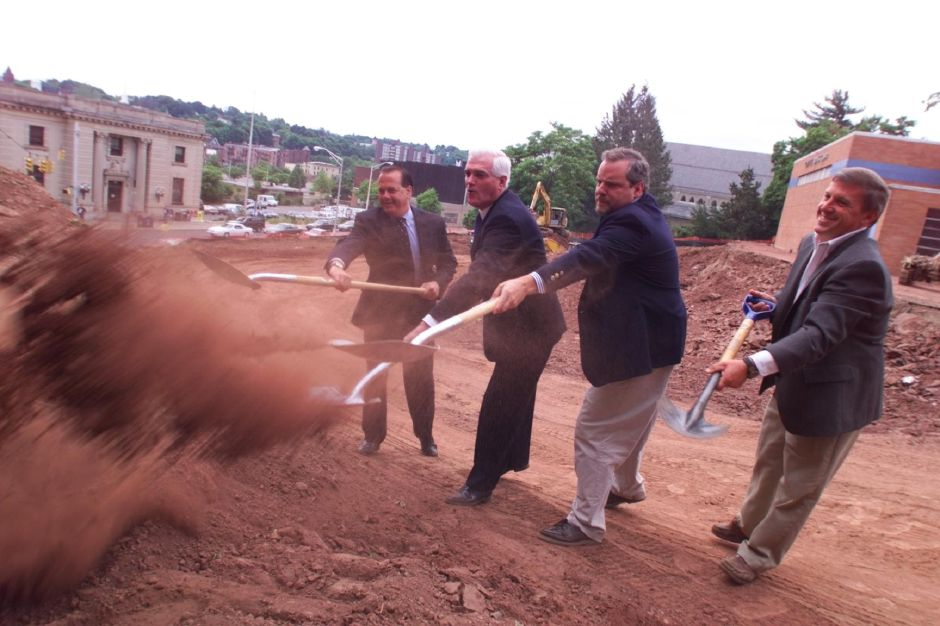 RJ file photo - From left, Tom Gaffey, Joe Marinan,Jr., Jim Abrams and Meriden Boys Club president Dan Roman turn some earth at the club
