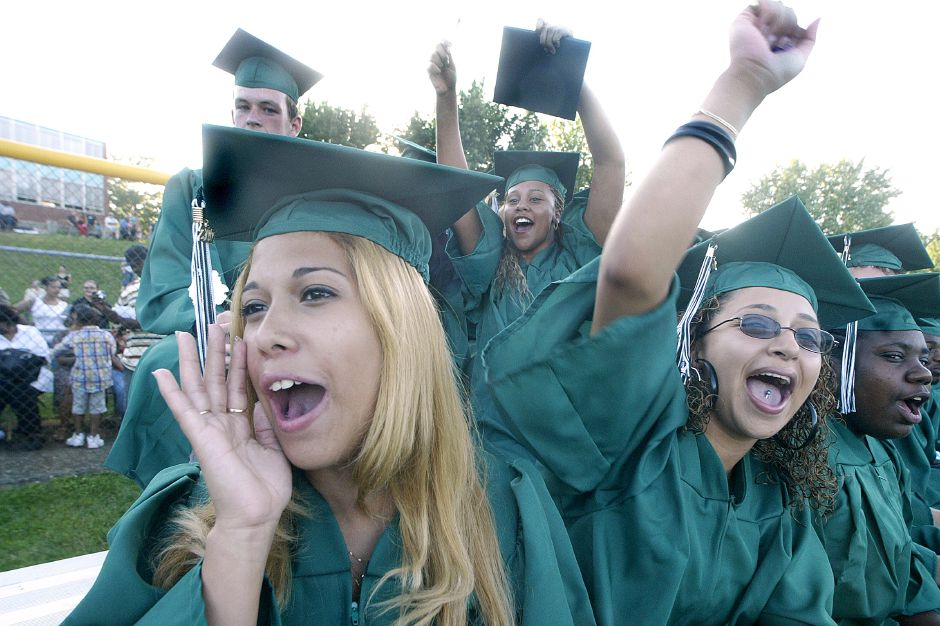 Record Journal Photo/ Johnathon Henninger 6.18.07 left, Yesslyn Medina, right, Carolin Medina and center Elixus Green (CQ on all of them) cheer for classmates at the Maloney High School Graduation in Meriden Monday afternoon.