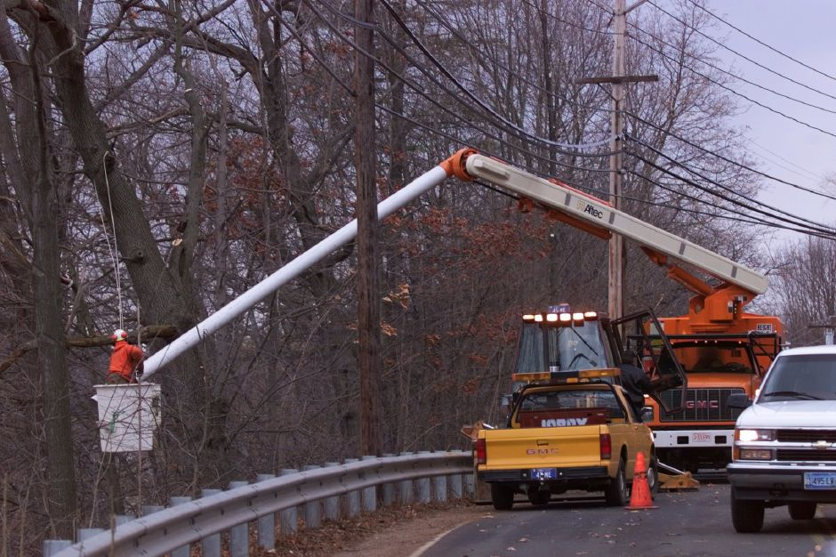 RJ file photo - Crews trimming trees near power lines on Hanover Street in Meriden March 4, 1999.