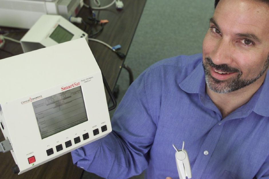 Leo F. Costelle Jr., presdient of Clinical Dynamics of Wallingford displays Pulse Oximetry Analyzer designed by Clinical Dynamics, July 2000. The company recently won an annual Readers Choice award for best biomedical testing device.