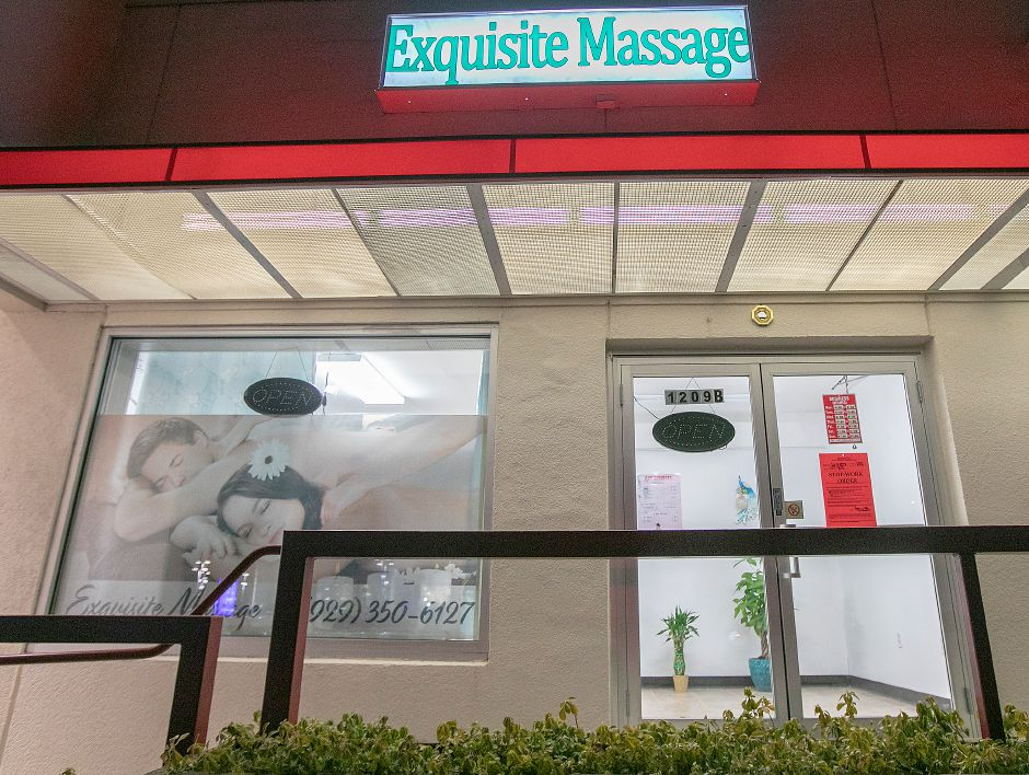 Investigators from the state Department of Labor wage & workplace standards division close down Exquisite Massage with a stop-work order at 1209B South Broad St. in Wallingford on Jan. 30. Dave Zajac, Record-Journal