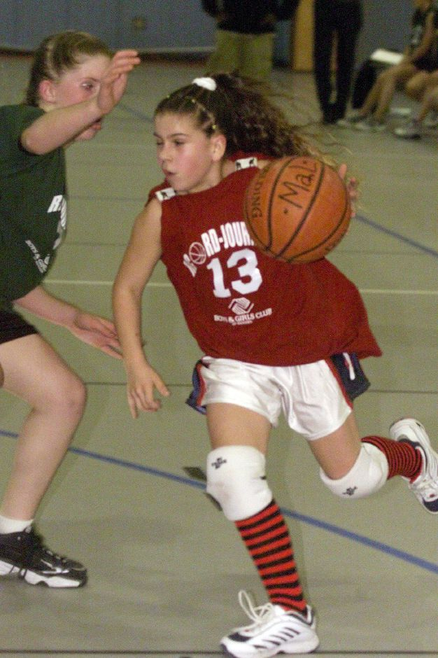 Mallorie M. Michalak, #13 for J. Fiderio & Sons, moves past a player for the Insurance Center of Central Ct. team Wed. night, Jan. 10, 2001 at the Boys and Girls Club