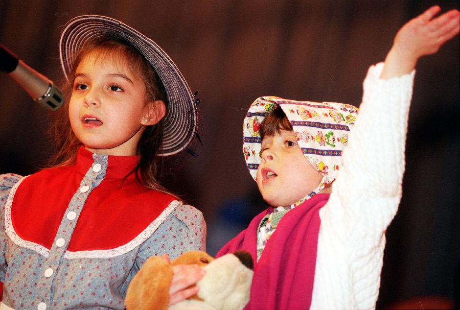 Jodie Christopoulos, left, and Bailey Cronin, right, perform with their class at Stevens Elementary School in Wallingford, in Little Bo Peep. This is the morning kindergarden class, April 2000.