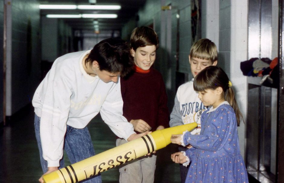 RJ file photo - Students at Plantsville School in Southington put pennies in a crayon bank for The Jesse Fund in memory of classmate Jesse Riccitelli, who died of cancer. Jan. 1990.